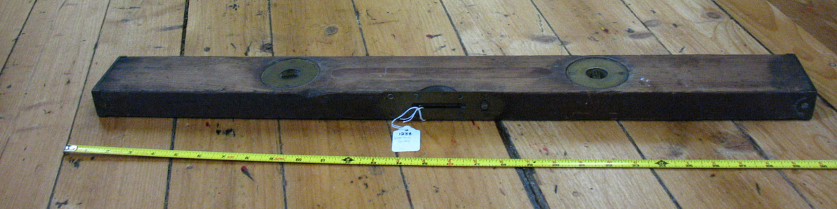 Wooden level on brass plate